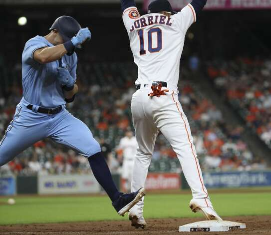 Houston Astros first baseman Yuli Gurriel (10) gets Toronto Blue Jays center fielder Randal Grichuk (15) out at first base during the eighth inning of an MLB game Saturday, May 8, 2021, at Minute Maid Park in Houston. Photo: Jon Shapley/Staff Photographer / © 2021 Houston Chronicle