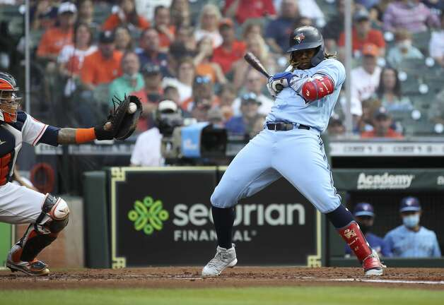 Toronto Blue Jays first baseman Vladimir Guerrero Jr. (27) dodges a pitch during the third inning of an MLB game Saturday, May 8, 2021, at Minute Maid Park in Houston. Photo: Jon Shapley/Staff Photographer / © 2021 Houston Chronicle