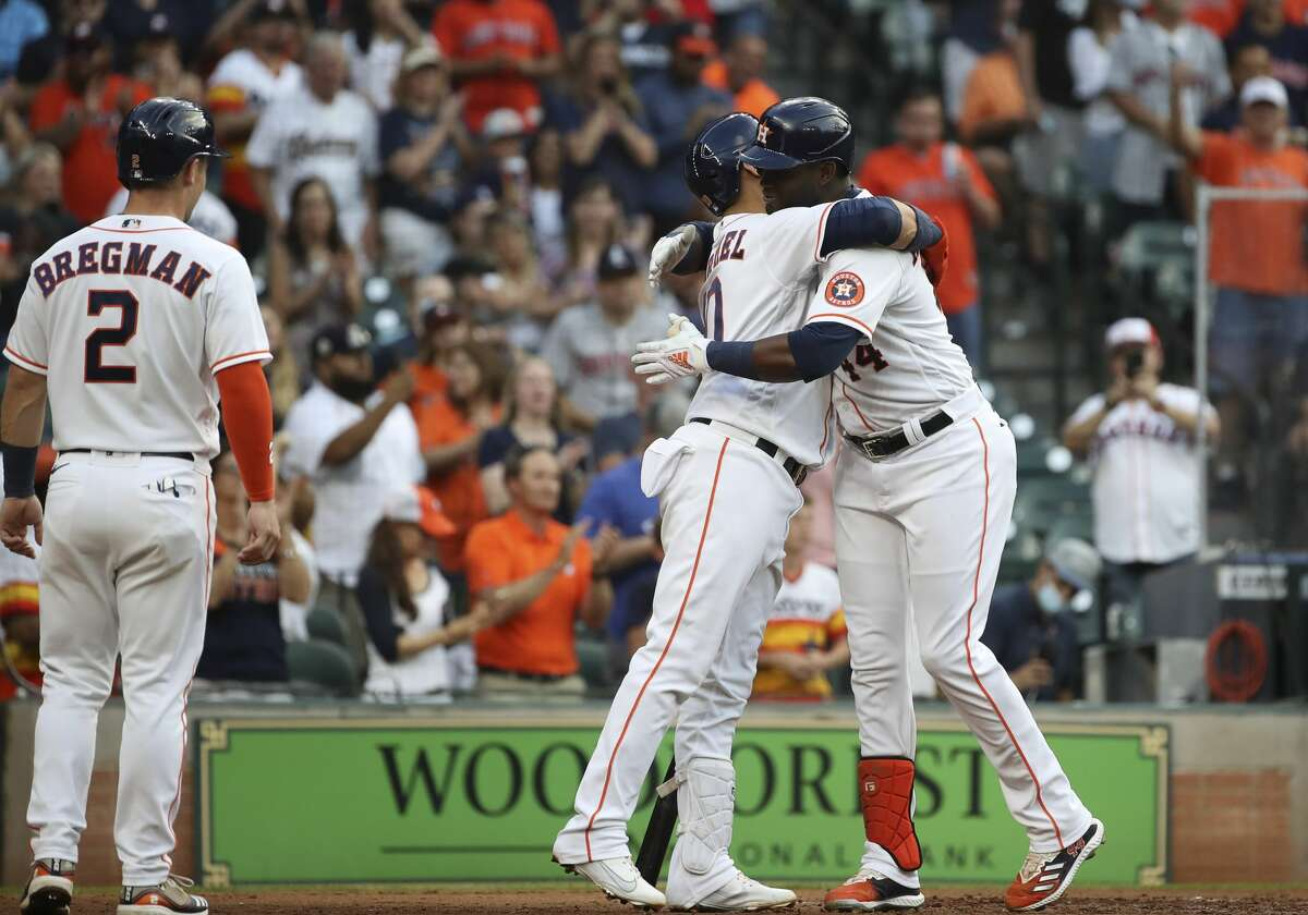 Houston Astros designated hitter Yordan Alvarez (44) gets a hug from first baseman Yuli Gurriel (10) after he hit a home run during the fourth inning of an MLB game Saturday, May 8, 2021, at Minute Maid Park in Houston.