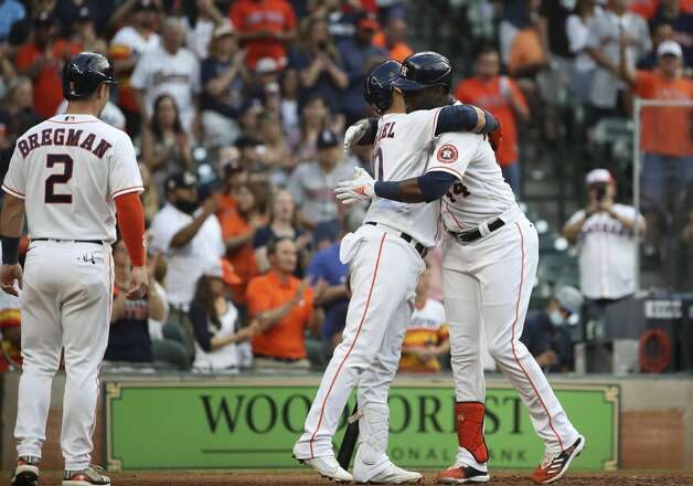 Houston Astros designated hitter Yordan Alvarez (44) gets a hug from first baseman Yuli Gurriel (10) after he hit a home run during the fourth inning of an MLB game Saturday, May 8, 2021, at Minute Maid Park in Houston. Photo: Jon Shapley/Staff Photographer / © 2021 Houston Chronicle