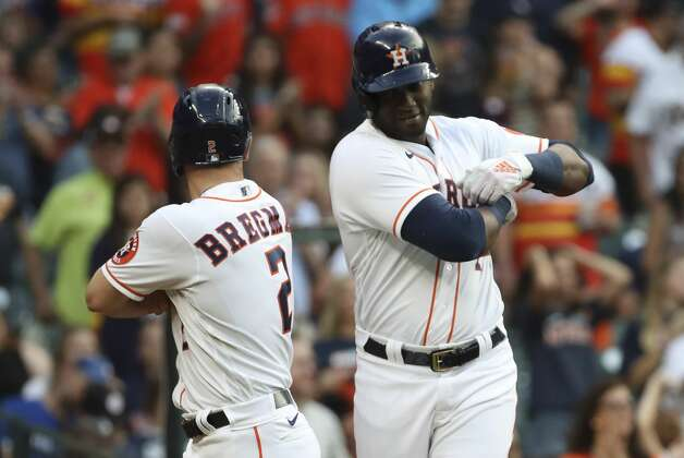 Houston Astros designated hitter Yordan Alvarez (44) celebrates with third baseman Alex Bregman (2) after he hit a home run during the fourth inning of an MLB game Saturday, May 8, 2021, at Minute Maid Park in Houston. Photo: Jon Shapley/Staff Photographer / © 2021 Houston Chronicle