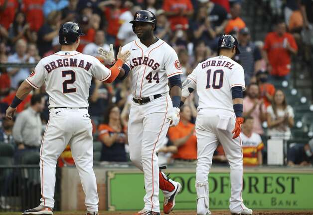Houston Astros designated hitter Yordan Alvarez (44) high-fives third baseman Alex Bregman (2) after he hit a two-run home run during the fourth inning of an MLB game Saturday, May 8, 2021, at Minute Maid Park in Houston. Photo: Jon Shapley/Staff Photographer / © 2021 Houston Chronicle