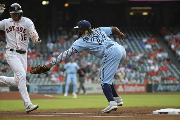 Toronto Blue Jays first baseman Vladimir Guerrero Jr. (27) tags Houston Astros left fielder Aledmys Diaz (16) out at first during the first inning of an MLB game Saturday, May 8, 2021, at Minute Maid Park in Houston. Photo: Jon Shapley/Staff Photographer / © 2021 Houston Chronicle