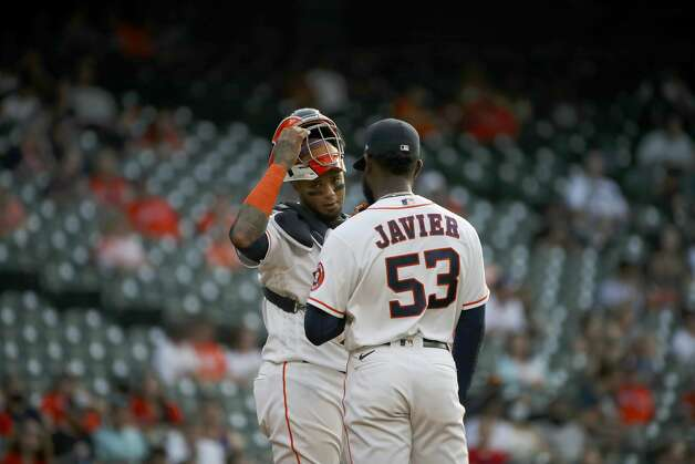 Houston Astros catcher Martin Maldonado (15) talks with starting pitcher Cristian Javier (53) during the third inning of an MLB game Saturday, May 8, 2021, at Minute Maid Park in Houston. Photo: Jon Shapley/Staff Photographer / © 2021 Houston Chronicle