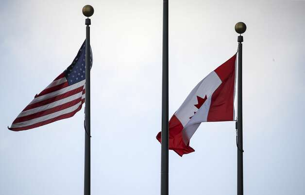 The American and Canadian flags fly before a game between the Houston Astros and the Toronto Blue Jays on Saturday, May 8, 2021, at Minute Maid Park in Houston. Photo: Jon Shapley/Staff Photographer / © 2021 Houston Chronicle