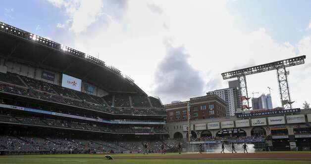 The grounds crew prepares the field for a game between the Houston Astros and the Toronto Blue Jays on Saturday, May 8, 2021, at Minute Maid Park in Houston. Photo: Jon Shapley/Staff Photographer / © 2021 Houston Chronicle