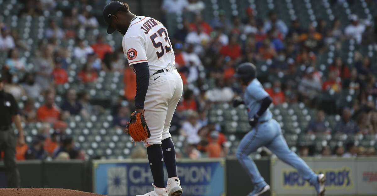 Houston Astros starting pitcher Cristian Javier (53) waits as Toronto Blue Jays catcher Danny Jansen (9) rounds the bases after hitting a home run during the third inning of an MLB game Saturday, May 8, 2021, at Minute Maid Park in Houston.