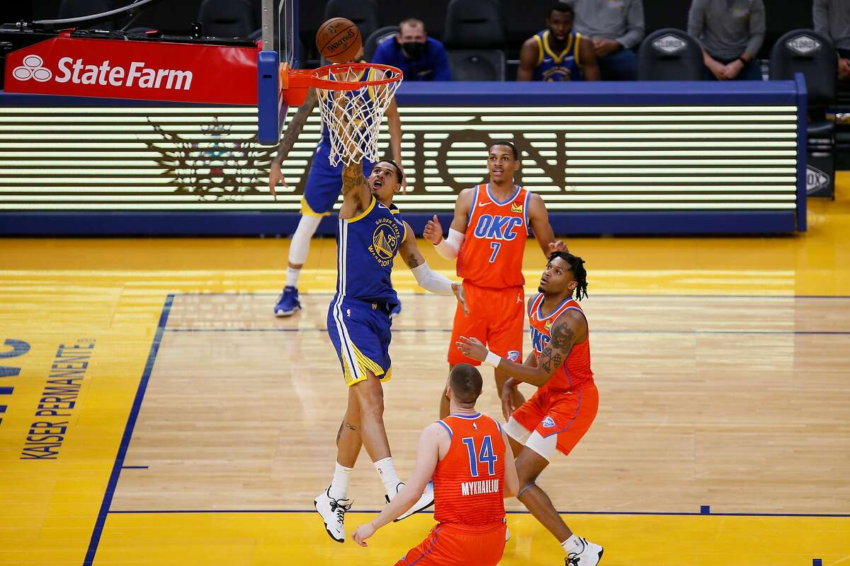 Golden State Warriors forward Juan Toscano-Anderson (95) scores on a layup in the first quarter of an NBA game against the Oklahoma City Thunder at Chase Center, Saturday, May 8, 2021, in San Francisco, Calif.
