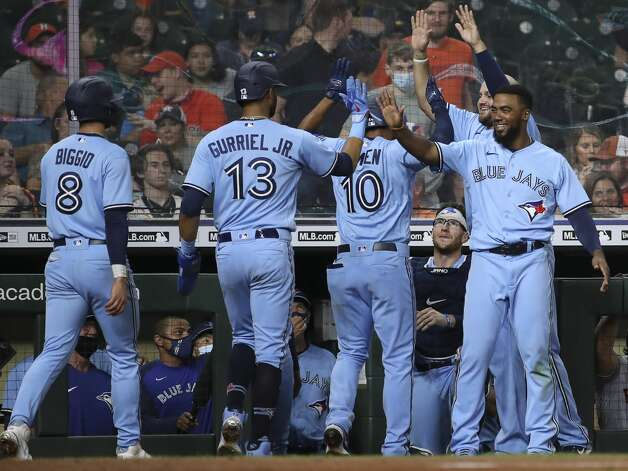 Toronto Blue Jays right fielder Teoscar Hernandez (37), right, and designated hitter Rowdy Tellez (44), behind him, celebrates with teammates after they scored on a home run by second baseman Marcus Semien (10) during the ninth inning of an MLB game Saturday, May 8, 2021, at Minute Maid Park in Houston. Photo: Jon Shapley/Staff Photographer / © 2021 Houston Chronicle