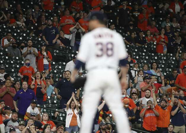 Fans cheer as Houston Astros relief pitcher Joe Smith (38) pitches during the ninth inning of an MLB game Saturday, May 8, 2021, at Minute Maid Park in Houston. Photo: Jon Shapley/Staff Photographer / © 2021 Houston Chronicle