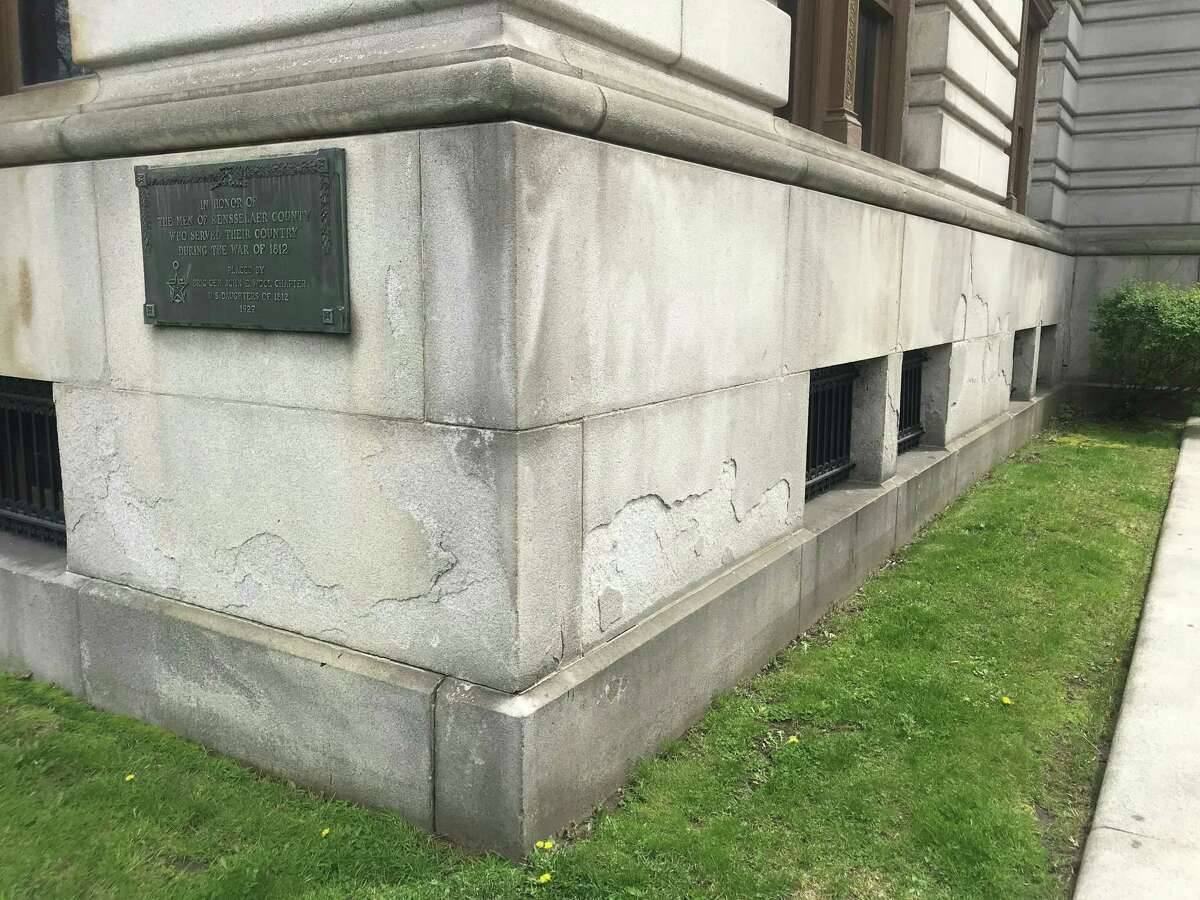At the corner of Congress and Second streets the damaged granite facade can be seen at the Rensselaer County Court House in Troy, N.Y.