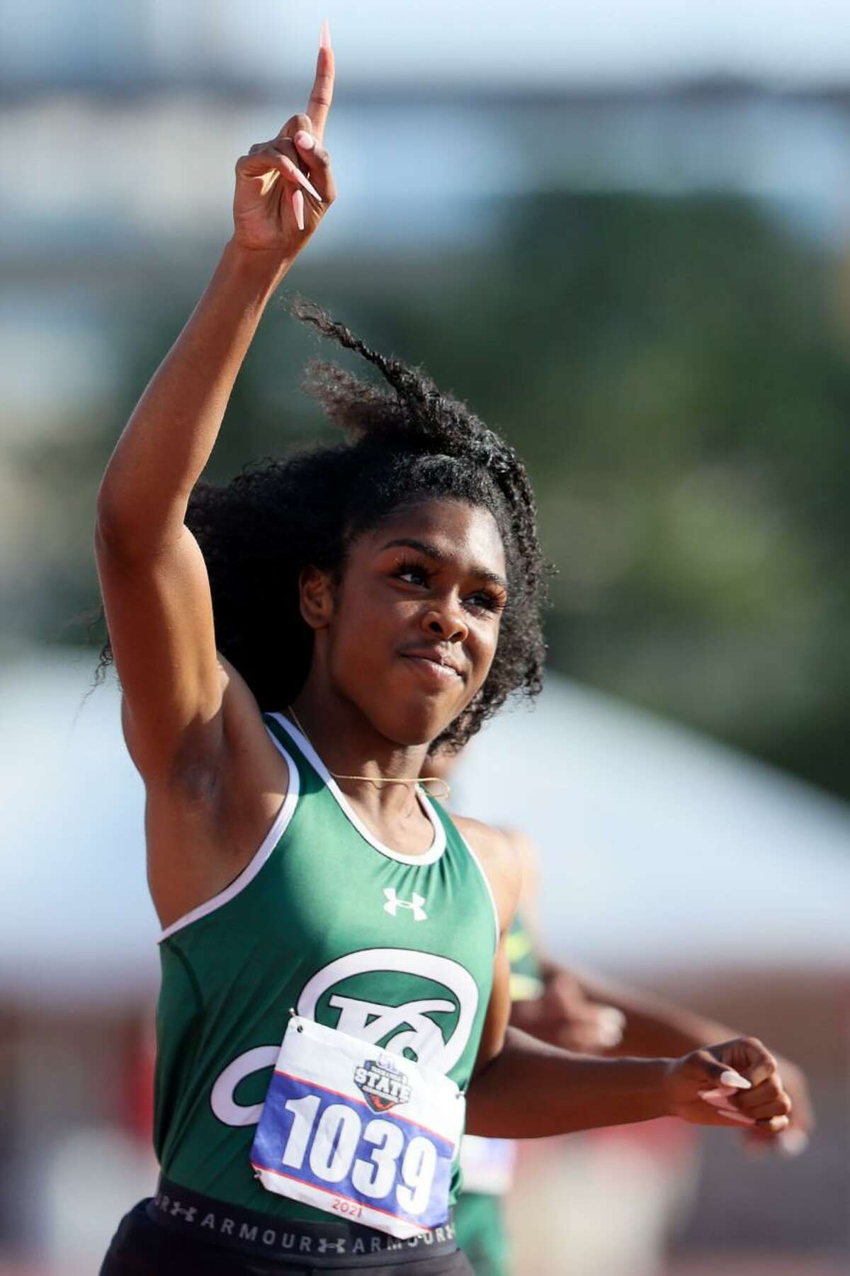 Reagan's Jasmine Montgomery celebrates after winning the 6A girls 100-meter dash with a time of 11.09 in the UIL state track and field championships at Mike A. Myers Stadium in Austin on Saturday, May 8, 2021.