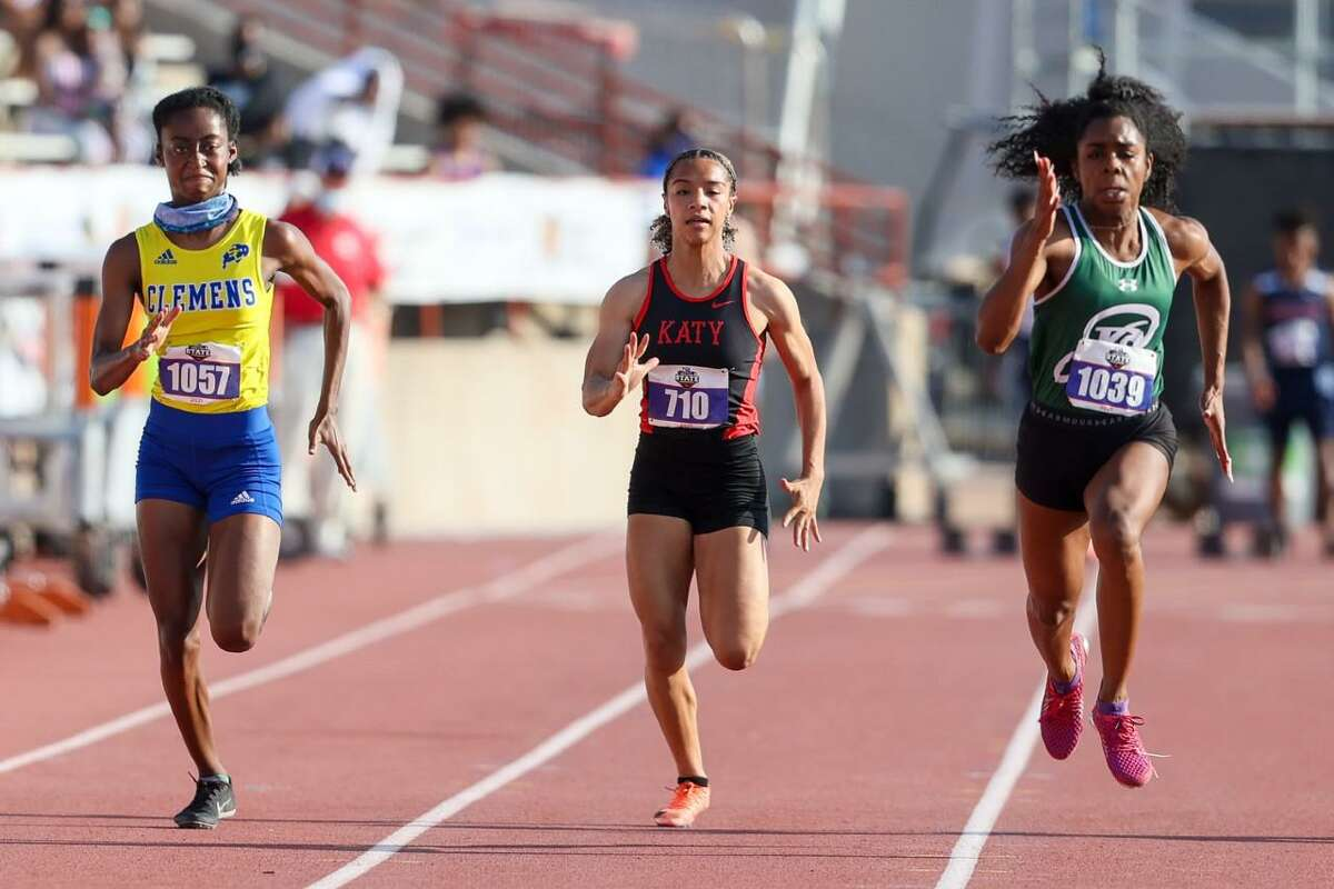 Reagan's Jasmine Montgomery, right, and Clemens Saniya Friendly, left, race to the finish line with Katy's Jada Campos in the UIL state track and field championships at Mike A. Myers Stadium in Austin on Saturday, May 8, 2021. Montgomery won the event with a time of 11.09 and Friendly took second in 11.44.