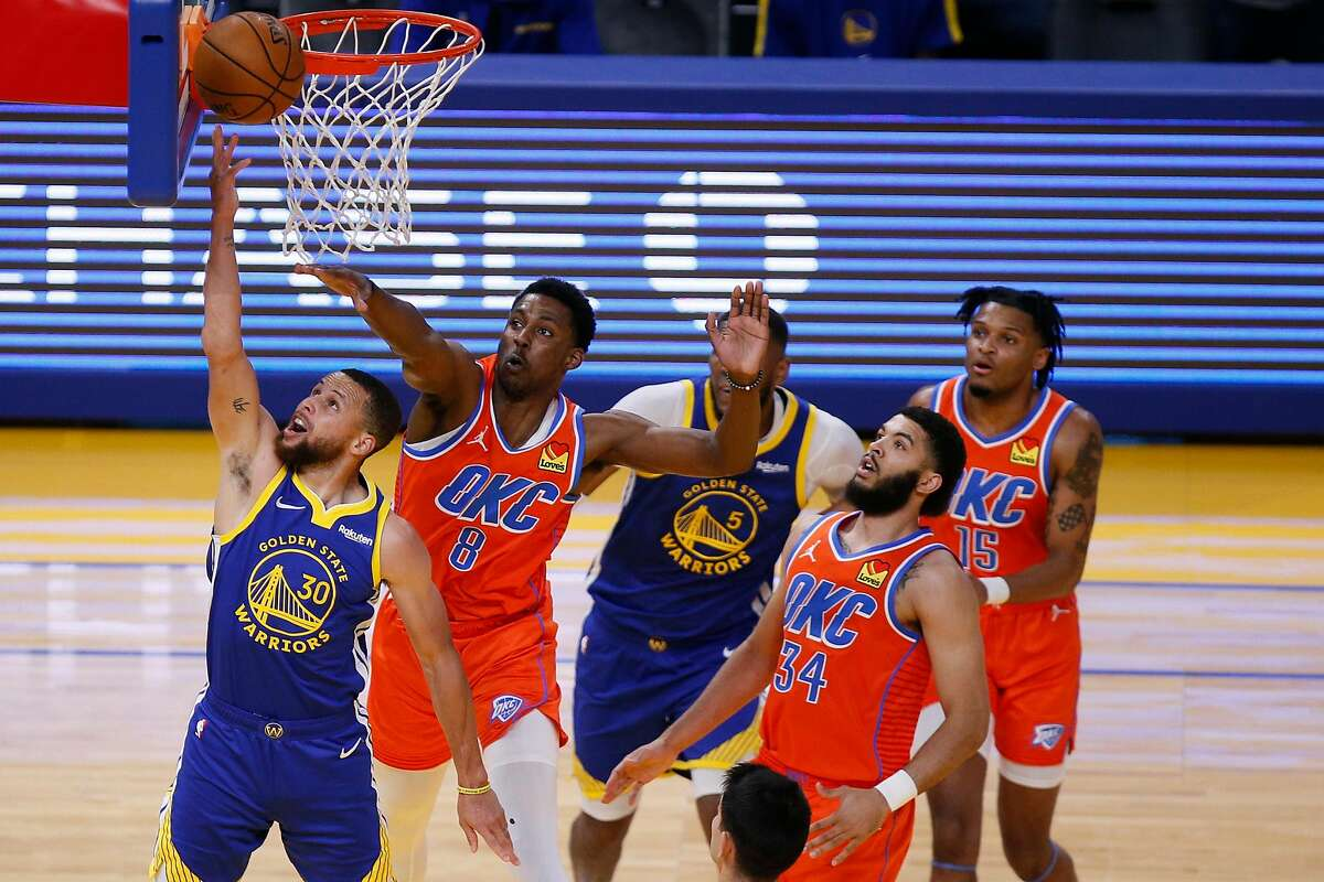 Golden State Warriors guard Stephen Curry (30) scores on a reverse layup against the Oklahoma City Thunder in the ending seconds of the first quarter in an NBA game at Chase Center, Saturday, May 8, 2021, in San Francisco, Calif.