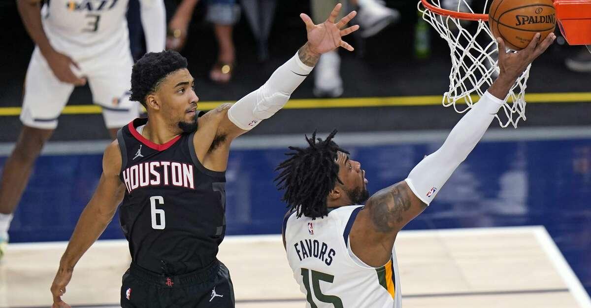 Houston Rockets forward Kenyon Martin Jr. (6) defends against Utah Jazz center Derrick Favors (15) during the first half of an NBA basketball game Saturday, May 8, 2021, in Salt Lake City. (AP Photo/Rick Bowmer)