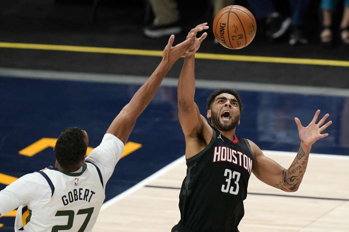 Houston Rockets forward Anthony Lamb (33) grabs a rebound as Utah Jazz center Rudy Gobert (27) defends during the first half of an NBA basketball game Saturday, May 8, 2021, in Salt Lake City. (AP Photo/Rick Bowmer)