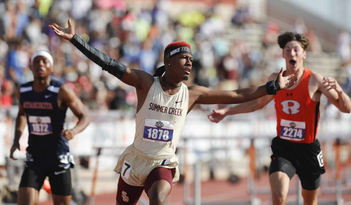 Barry Richards of Summer Creek celebrates after winning the boys 110-meter hurdles during the Class 6A state track and field meet Saturday in Austin.
