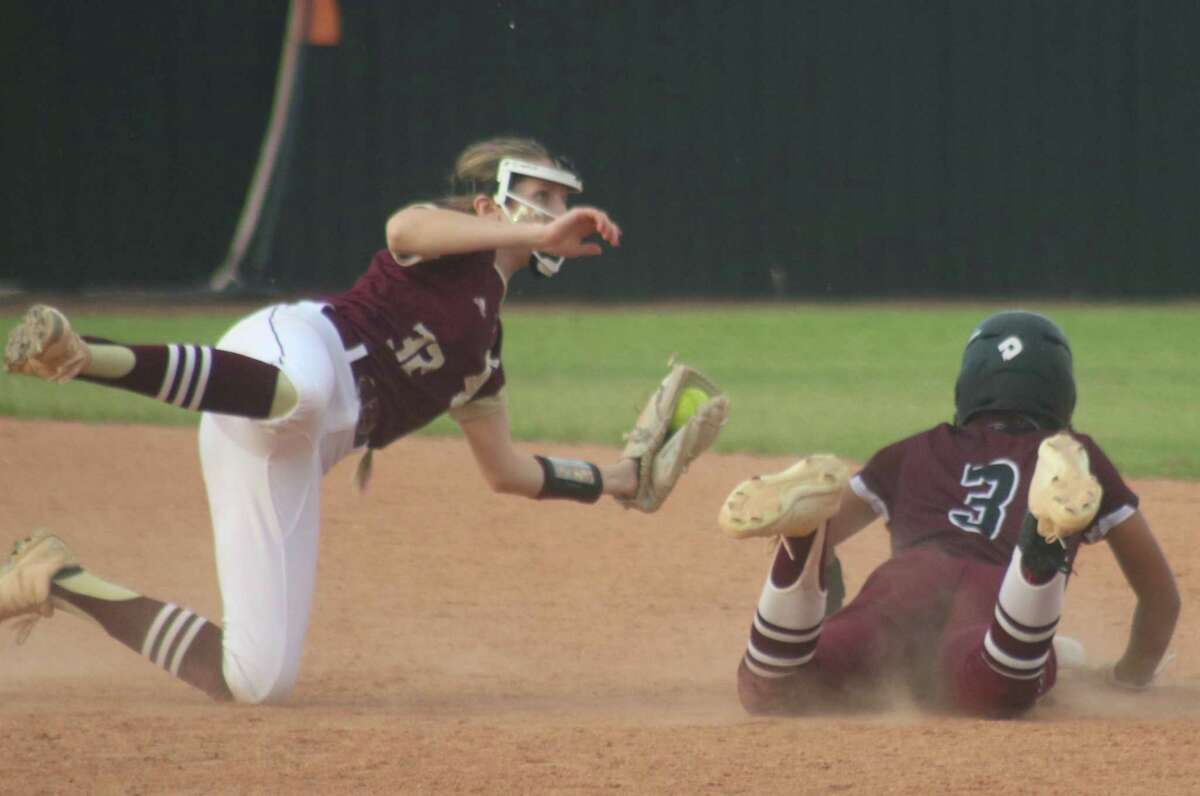 Shortstop Madison Bailey finishes applying the tag on a would-be Pearland basestealer Saturday night. Only four Pearland batters reached the basepaths after the first inning, just two reached second base.