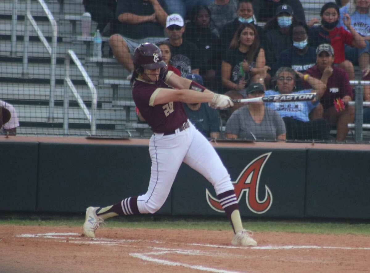 Madison Applebe shows nice form during this at-bat Saturday night. She kicked off a three-run uprising in the fourth that iced the Area crown.