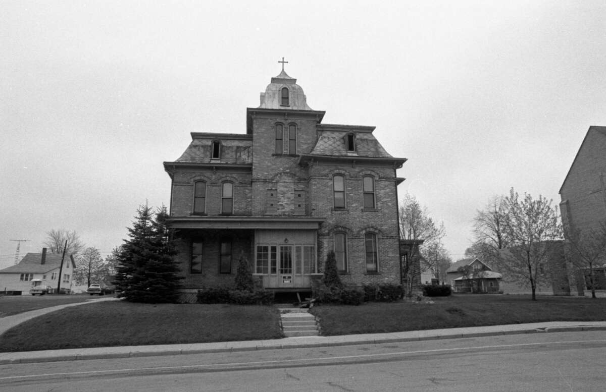 In a few days, the former rectory at St. Joseph Catholic Church will be torn down. A new parish center will be constructed on the property. The photo was taken in early May 1981. (Manistee County Historical Museum photo)
