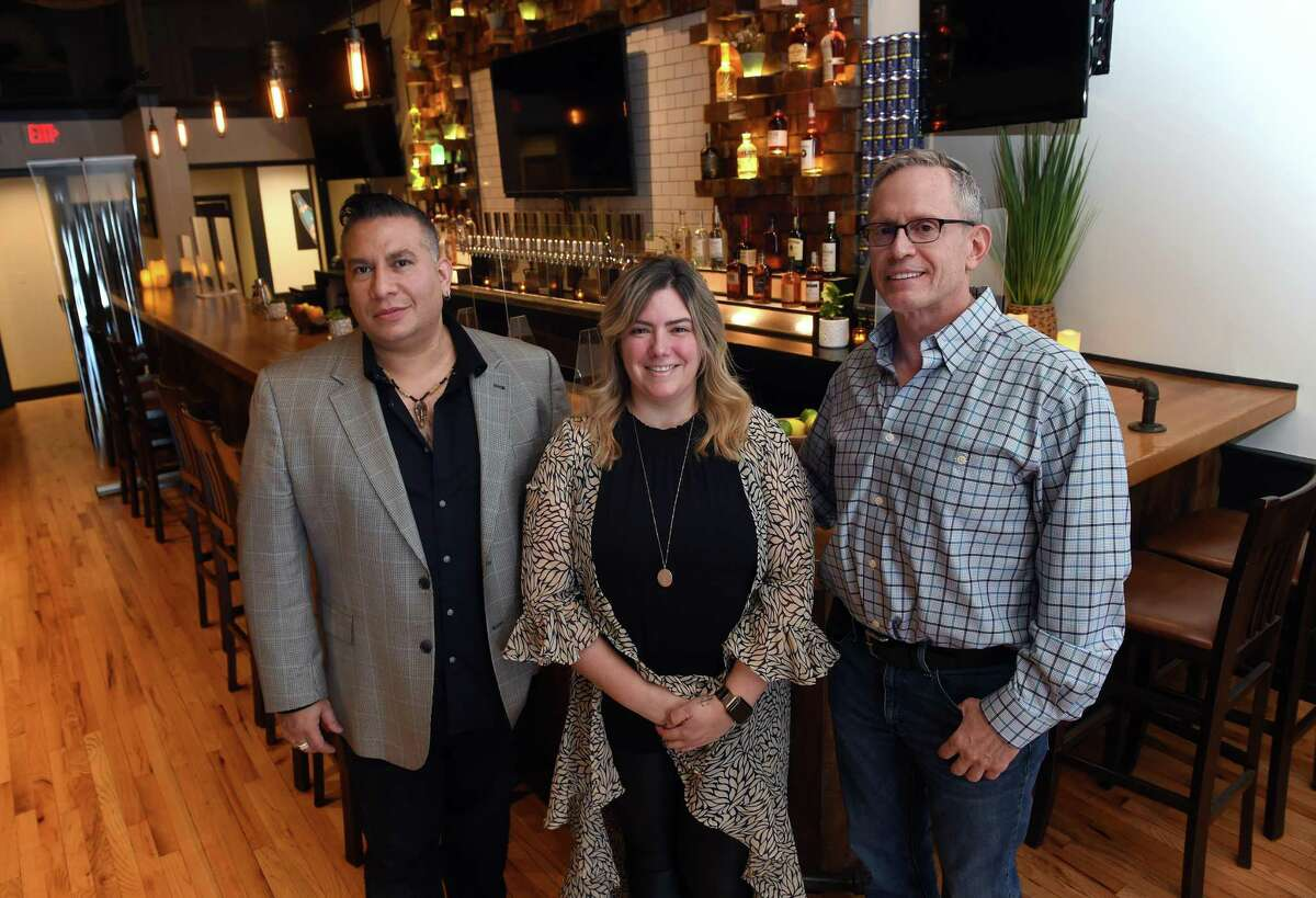 Prime 16 co-owners Joseph Hamboussi (left) and Robert Potter (right) photographed with beverage and events director Jessica Cinar in the remodeled Orange restaurant on May 6, 2021.