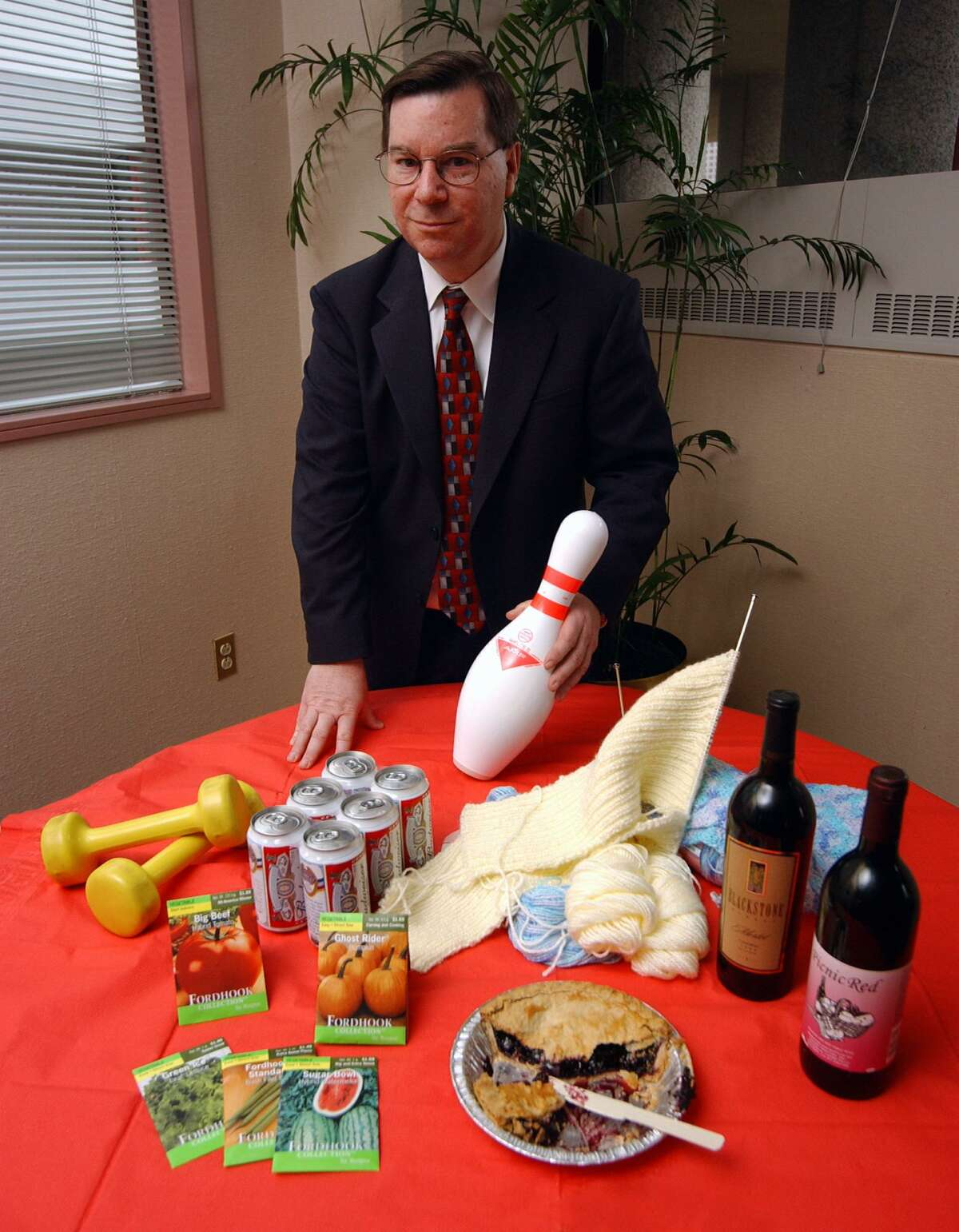 In 2002, then-House Minority Leader Robert Ward stood with items that Republicans claimed that Democrats wanted to raise taxes on, including beer, wine, knitting wool, seeds, pie, gym memberships and bowling.