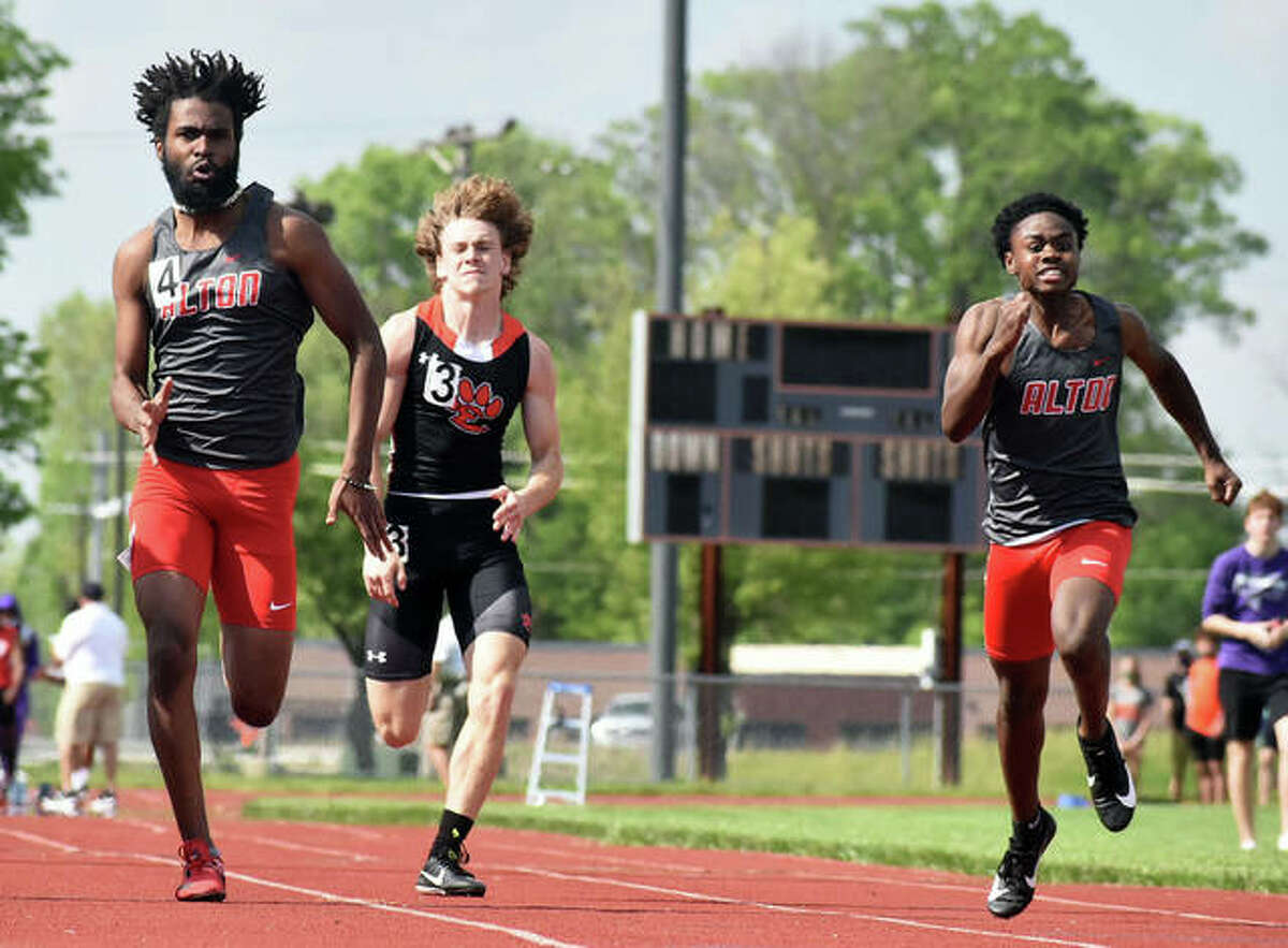 Alton's Kegan Bratton (left) leads teammate Samuel Elliott-Barnes (right) and Edwardsville's Carter Knoyle during a heat in the 100 meters Saturday in the Winston Brown Invite at the Winston Brown Track and Field Complex in Edwardsville.