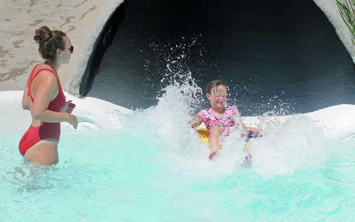 Raging Rivers Waterpark employee Olivia Yoswig, of Jerseyville waits for young people at the bottom of a water slide last July. The popular waterpark in Grafton opens Saturday, May 29, for the season.