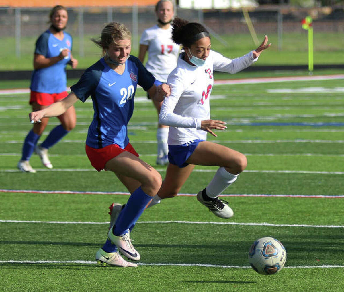 Roxana's Jada Covington (right) competes with Carlinville's Jill Stayton for ball during an April 29 match in Carlinville. On Saturday in Belleville, Covington scored a goal to help the Shells stay unbeaten with a 3-0 win over Highland in the Metro Cup.