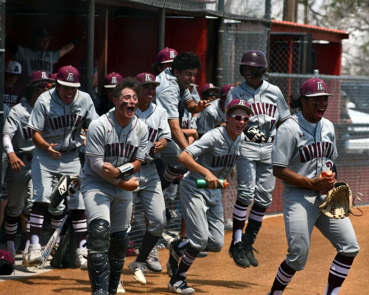 Abernathy players celebrate a run during game two of their UIL Class 2A bi-district baseball playoff series against Amarillo River Road on Saturday at Lockney.
