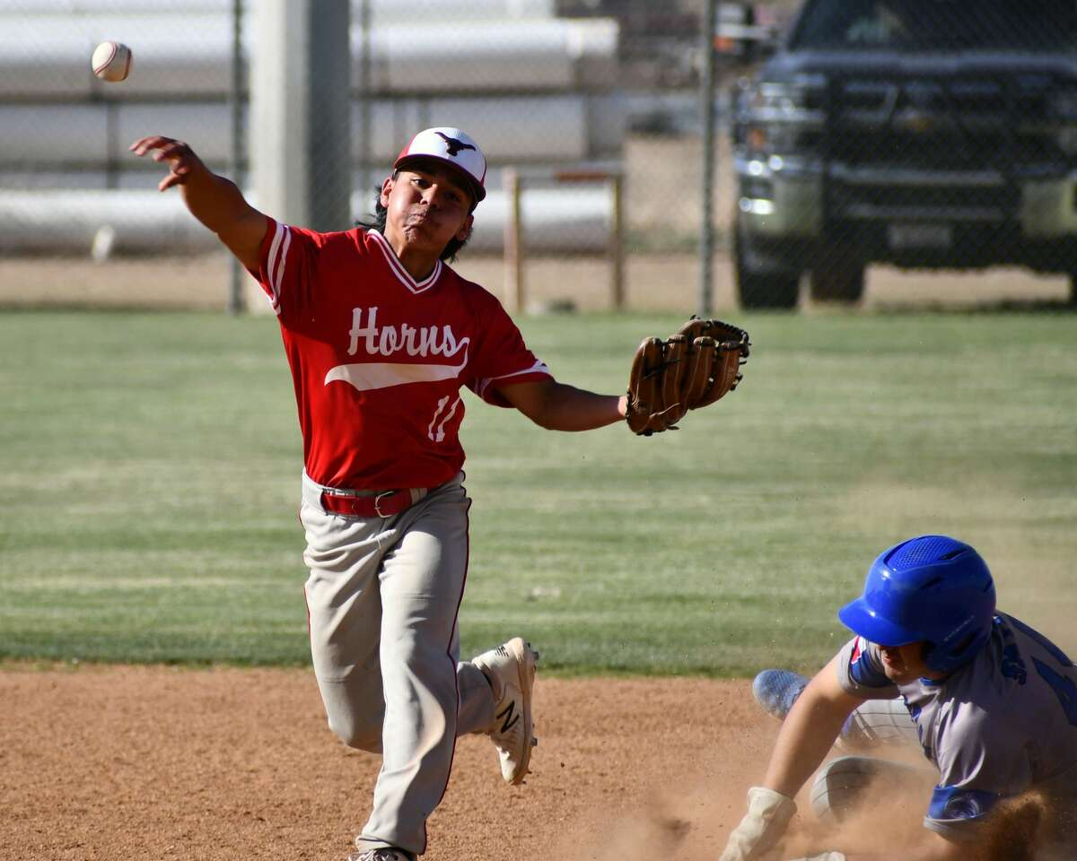 Lockney second baseman Damion Gonzales throws over to first for a double play during game two of a UIL Class 2A bi-district baseball playoff series against Smyer on Saturday at Abernathy.
