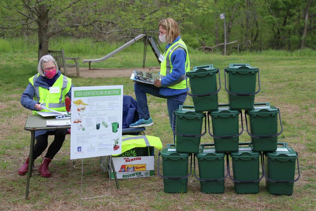 Volunteers Luisa Francoeur, left, and Julie Macdonald, both of Westport, plan for the day at the recycling event at Earthplace via Sustainable Westport on Saturday, May 8, 2021, in Westport, Conn.