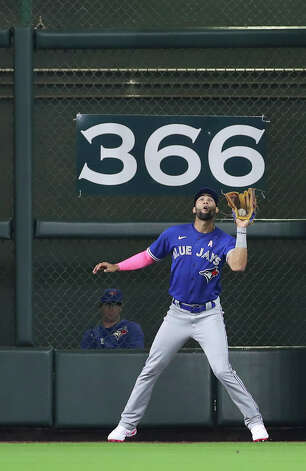Toronto Blue Jays left fielder Lourdes Gurriel Jr. (13) catches a fly ball hit by Houston Astros third baseman Alex Bregman (2) during the first inning of an MLB game Sunday, May 9, 2021, at Minute Maid Park in Houston. Photo: Jon Shapley, Staff Photographer / © 2021 Houston Chronicle