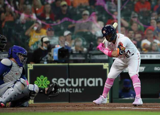 Houston Astros second baseman Jose Altuve (27) gets pushed back by an inside pitch during the first inning of an MLB game Sunday, May 9, 2021, at Minute Maid Park in Houston. Photo: Jon Shapley, Staff Photographer / © 2021 Houston Chronicle