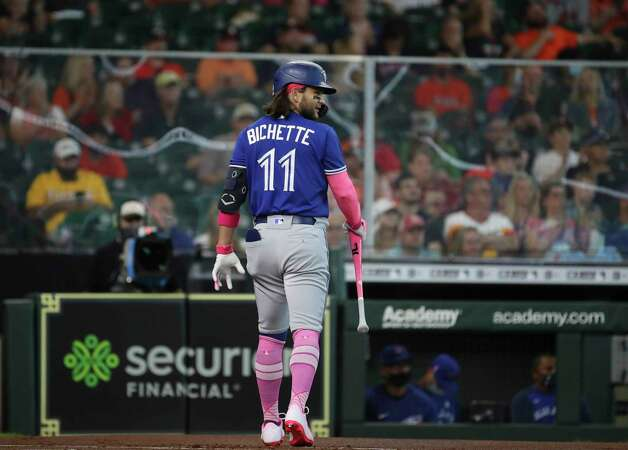 Toronto Blue Jays shortstop Bo Bichette (11) walks back to the dugout after striking out during the first inning of an MLB game Sunday, May 9, 2021, at Minute Maid Park in Houston. Photo: Jon Shapley, Staff Photographer / © 2021 Houston Chronicle