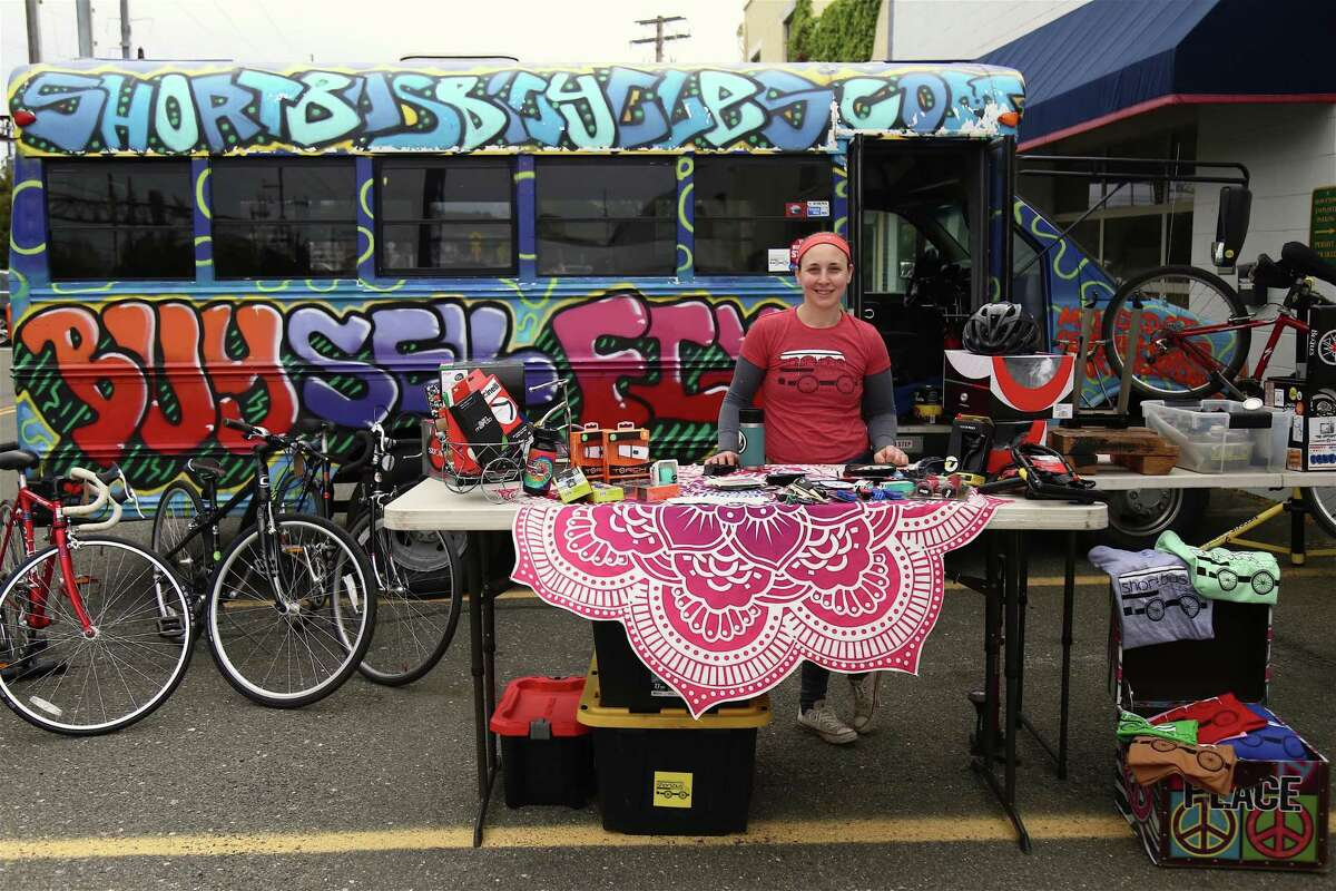 Erienne Murphy, co-owner of Shortbus Bicyles of Milford, stands by their mobile store at the pop-up market on Henry Carter Drive on Saturday, May 8, 2021, in Fairfield, Conn.