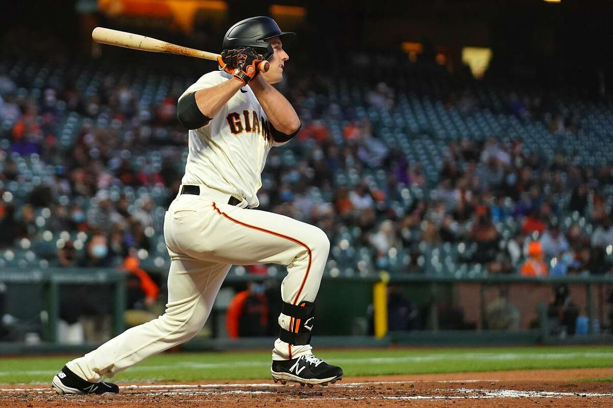 SAN FRANCISCO, CALIFORNIA - APRIL 27: Jason Vosler #32 of the San Francisco Giants hits an RBI double during the fourth inning against the Colorado Rockies at Oracle Park on April 27, 2021 in San Francisco, California. (Photo by Daniel Shirey/Getty Images)