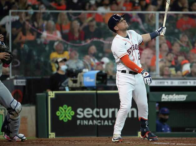 Houston Astros third baseman Alex Bregman (2) watches his fly ball with the bases loaded during the second inning of an MLB game Sunday, May 9, 2021, at Minute Maid Park in Houston. Photo: Jon Shapley, Staff Photographer / © 2021 Houston Chronicle