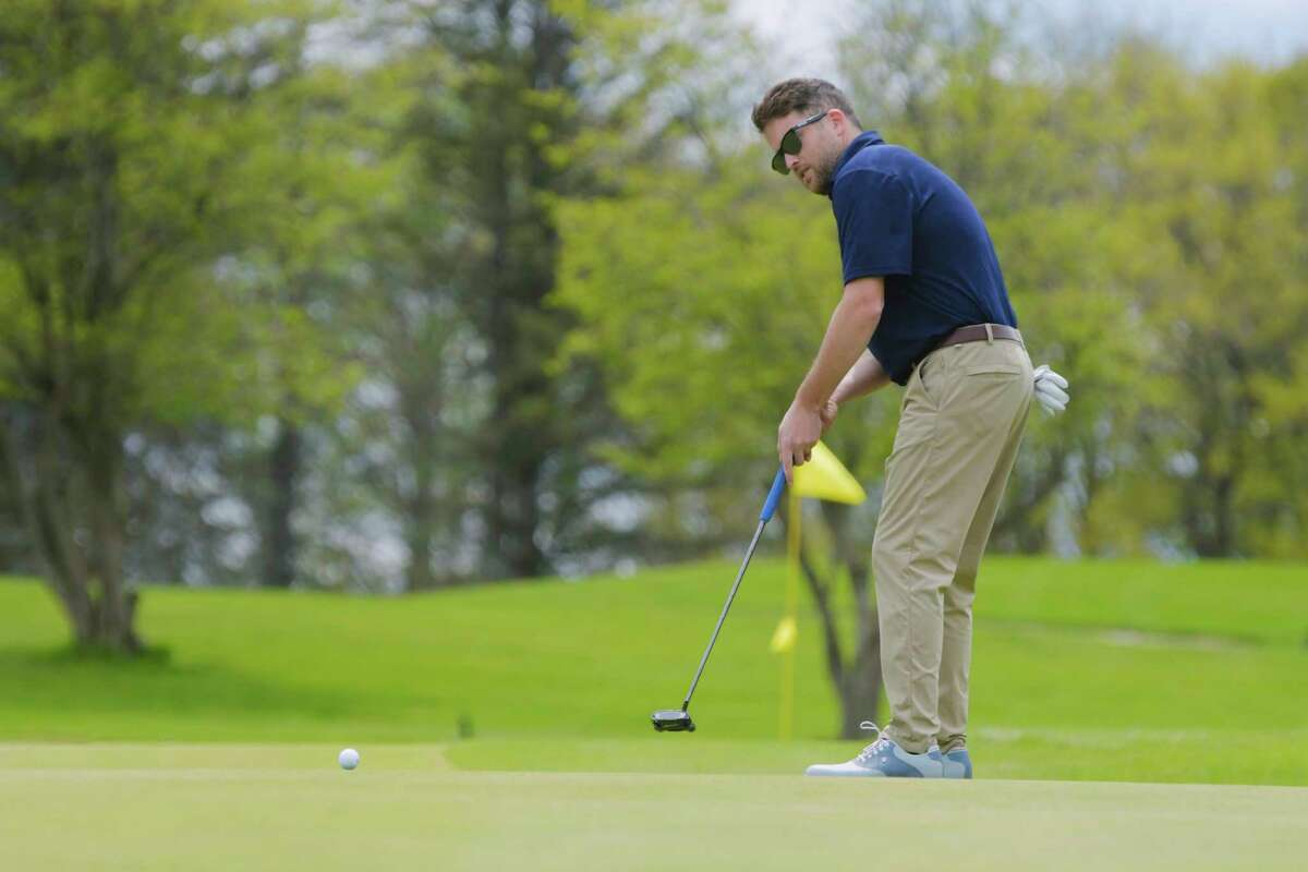 Steve Quillinan, Jr., hits a putt during the final of the Tri-County Golf Association Match Play Championship at the Colonie Golf and Country Club on Sunday, May 9, 2021, in Voorheesville, N.Y. (Paul Buckowski/Times Union)