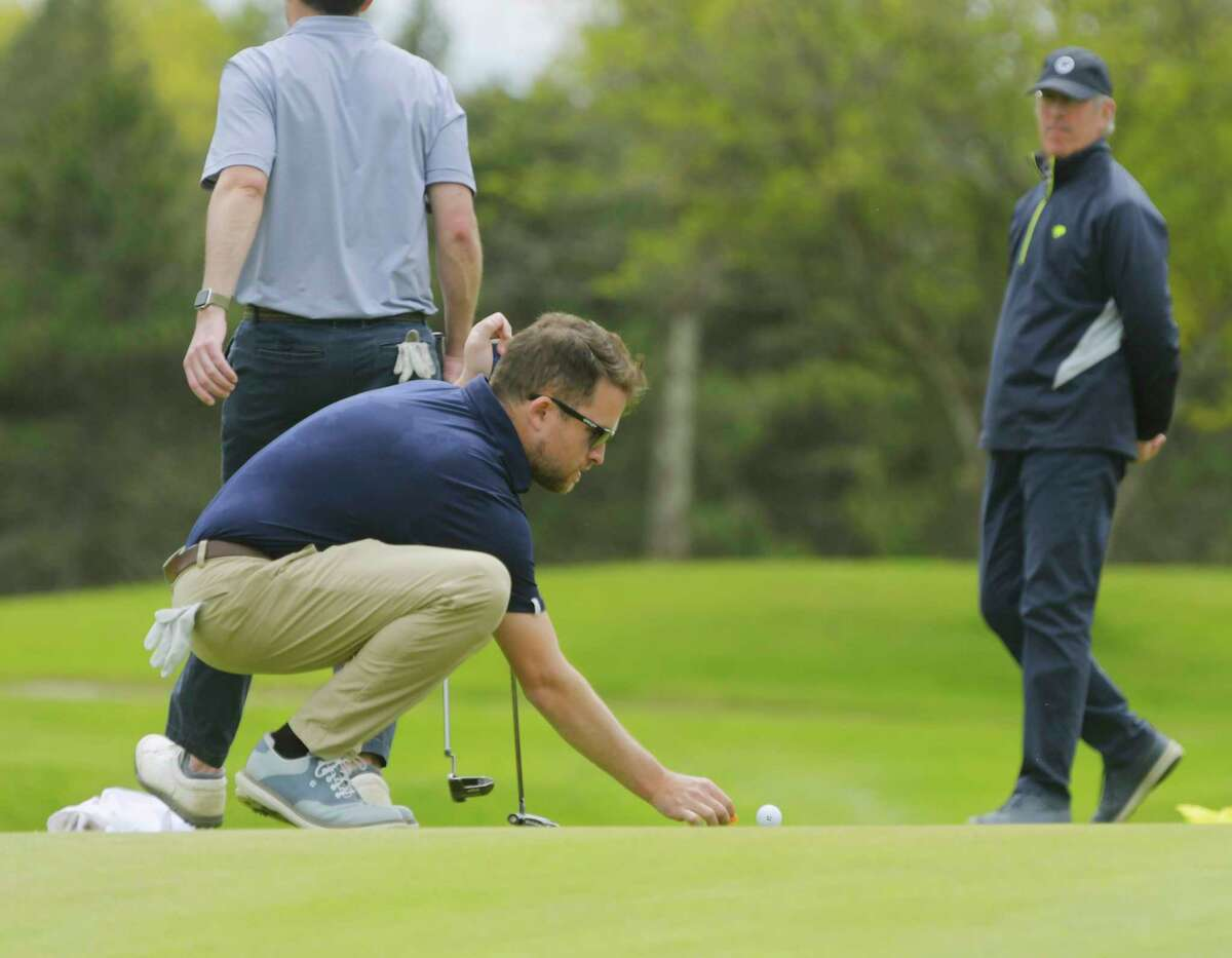 Steve Quillinan, Jr., places his ball back down on the green before putting during the final of the Tri-County Golf Association Match Play Championship at the Colonie Golf and Country Club on Sunday, May 9, 2021, in Voorheesville, N.Y. (Paul Buckowski/Times Union)