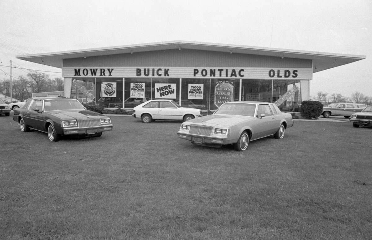 This is a view of the exterior of Mowry Buick Pontiac Olds which was formerly located at 309 W. Parkdale Ave, in Manistee. The photo was taken in early May 1981. (Manistee County Historical Museum photo)