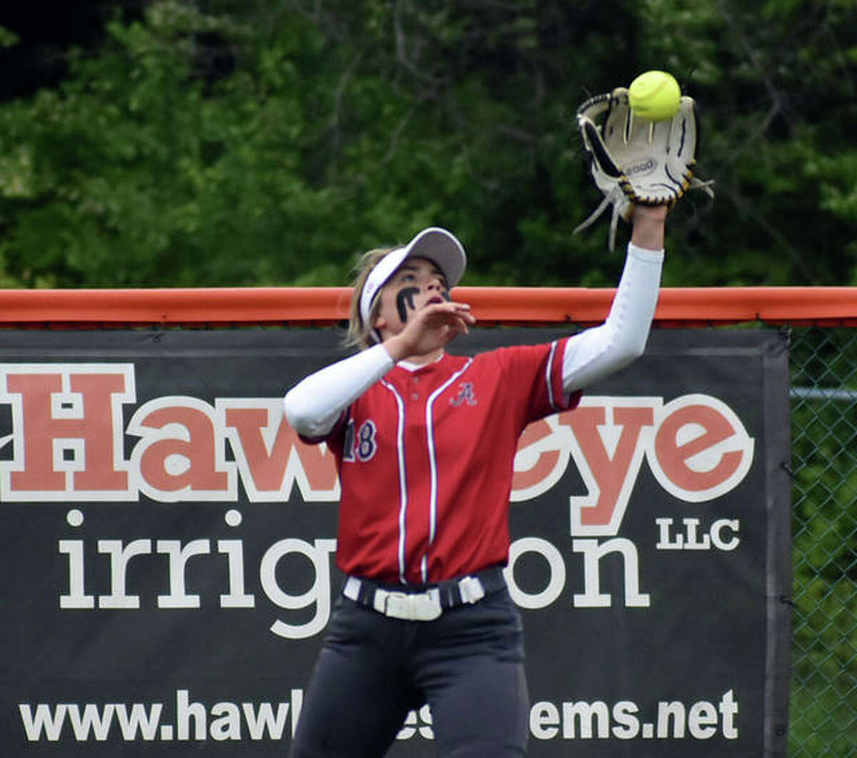 Alton right fielder Lauren O'Neil catches a line drive for the first out of the fourth inning of Saturday's game at Edwardsville.