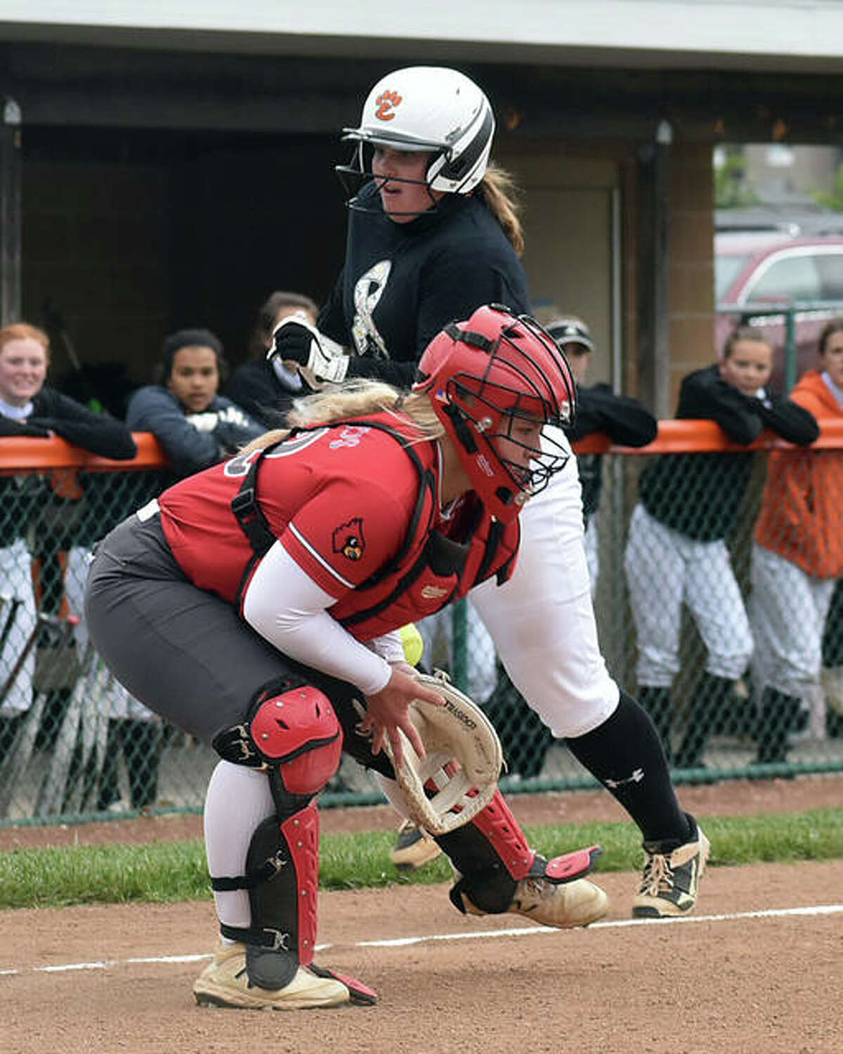 Edwardsville's Sam Sanders runs home as the throw eludes Alton catcher Lynna Fischer (left) in the second inning of Saturday's game inside the District 7 Sports Complex at Edwardsville.