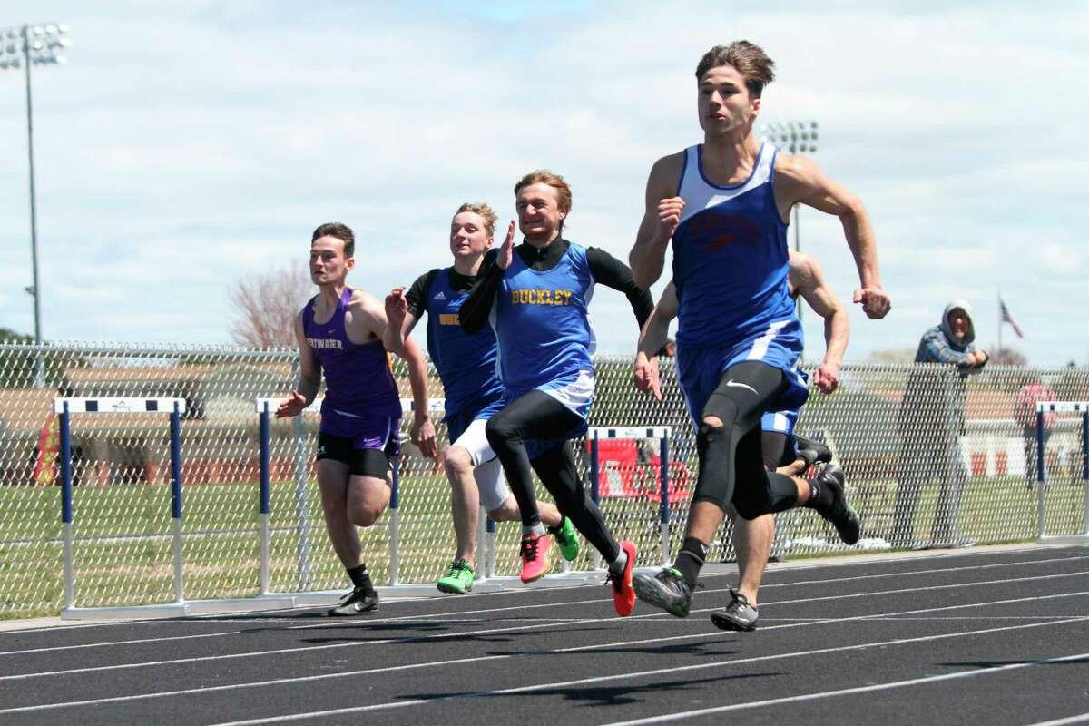 Manistee Catholic senior Mateo Barnett wins the 100-meter dash on Saturday at the Saber Flash Invite. (Dylan Savela/News Advocate)