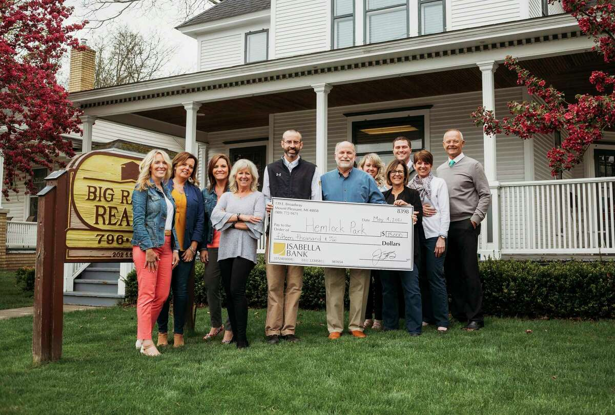 Hemlock Park Improvement Chairperson Jon Coles (center), along with members of Big Rapids Realtypresent a check for $15K which will help fund the project. (Photo courtesy/Jon Coles)