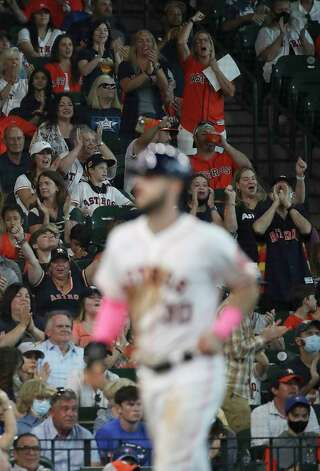 Fans cheer as Houston Astros right fielder Kyle Tucker (30) scores during the third inning of an MLB game Sunday, May 9, 2021, at Minute Maid Park in Houston. Photo: Jon Shapley, Staff Photographer / © 2021 Houston Chronicle