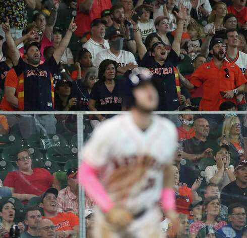 Fans cheer as they watch a home run ball hit by Houston Astros right fielder Kyle Tucker (30) during the fourth inning of an MLB game Sunday, May 9, 2021, at Minute Maid Park in Houston. Photo: Jon Shapley, Staff Photographer / © 2021 Houston Chronicle