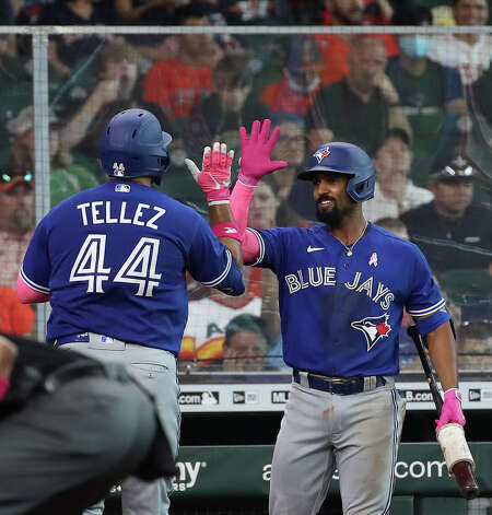 Toronto Blue Jays second baseman Marcus Semien (10) high-fives first baseman Rowdy Tellez (44) after he hit a home run during the fifth inning of an MLB game Sunday, May 9, 2021, at Minute Maid Park in Houston. Photo: Jon Shapley, Staff Photographer / © 2021 Houston Chronicle