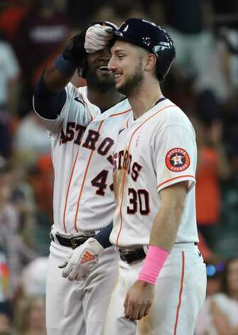 Houston Astros designated hitter Yordan Alvarez (44) takes the batting helmet off of right fielder Kyle Tucker (30) after he hit a home run during the fourth inning of an MLB game Sunday, May 9, 2021, at Minute Maid Park in Houston. Photo: Jon Shapley, Staff Photographer / © 2021 Houston Chronicle