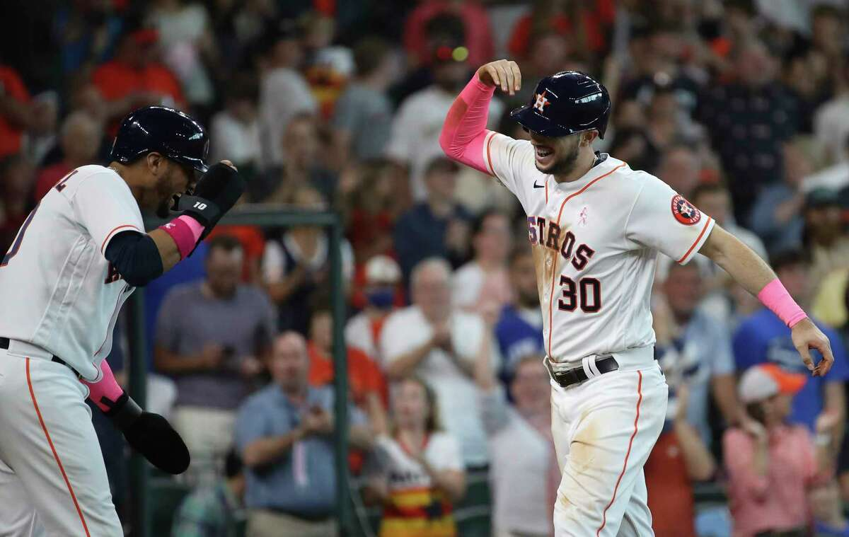 Houston Astros right fielder Kyle Tucker (30) celebrates with first baseman Yuli Gurriel (10) after he hit a home run during the fourth inning of an MLB game Sunday, May 9, 2021, at Minute Maid Park in Houston.